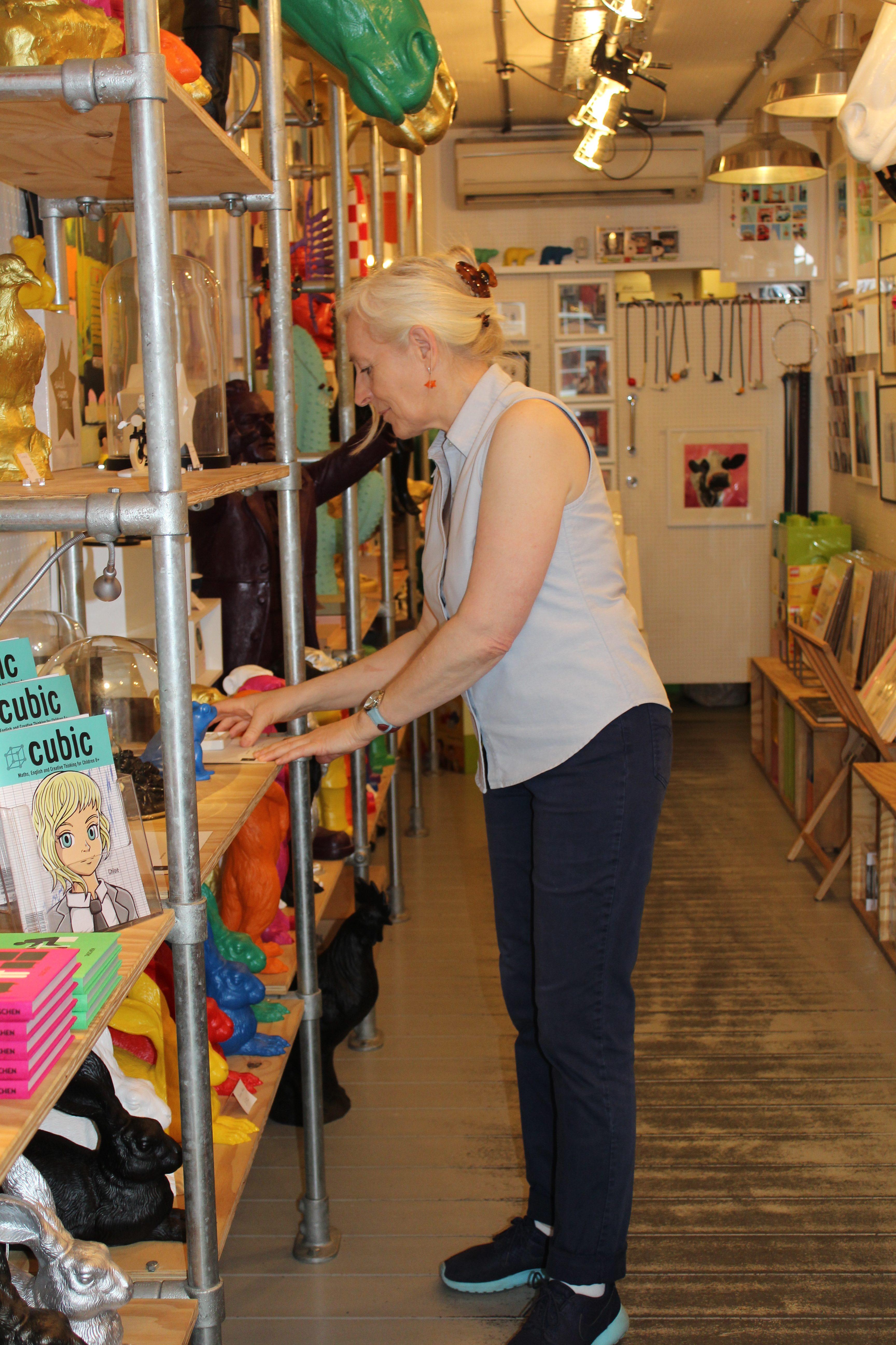 Entrepreneur Elizabeth Hirst working in her store, Tusch Und Egon. Photo by Carley Lerner