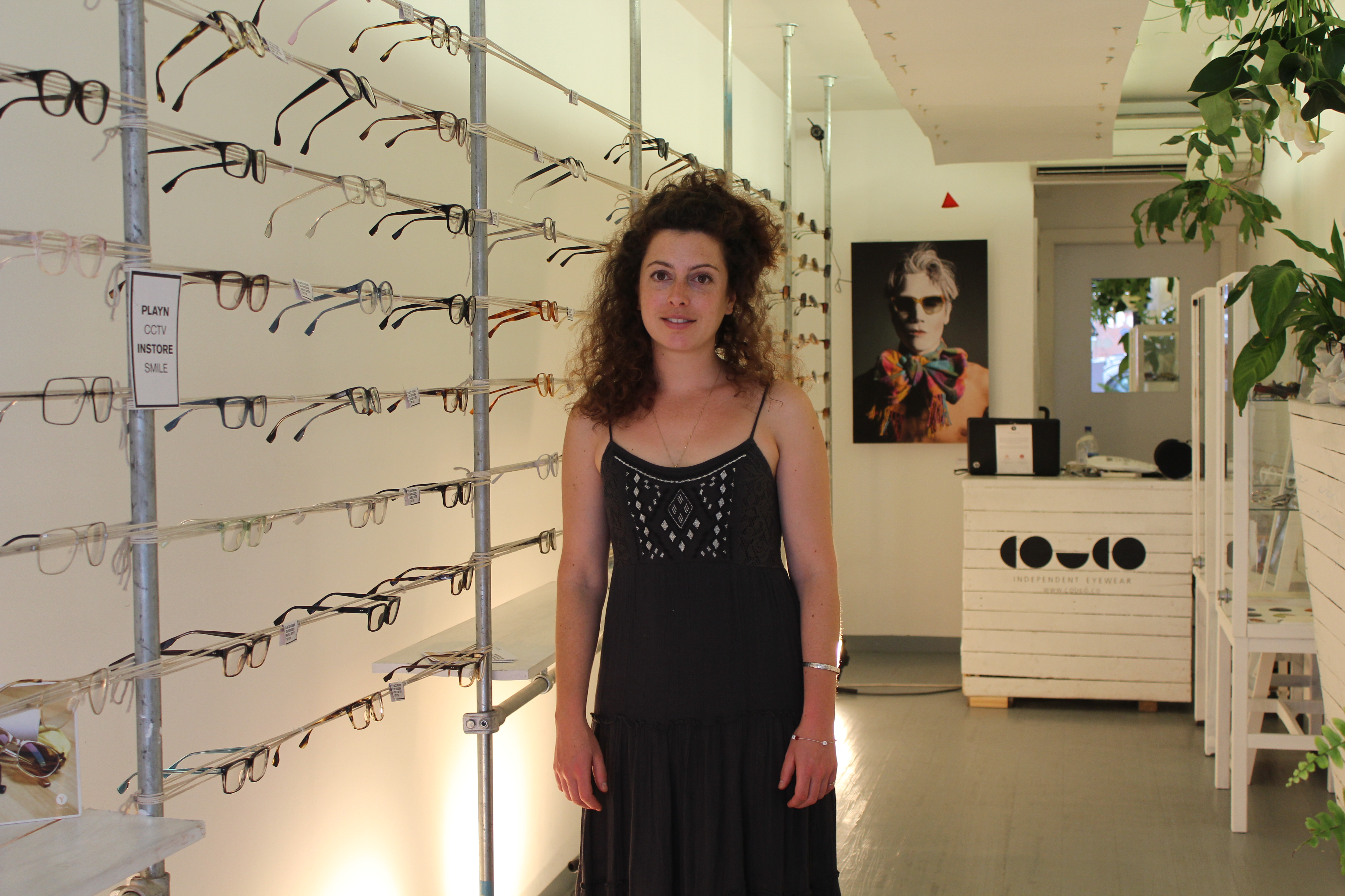 Tess Alshibaya, one of the entrepreneurs behind this independent eyewear business, stands with her store CouCo. Photo by Carley Lerner