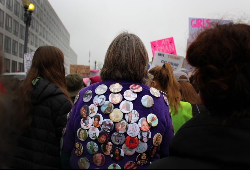 One woman donned buttons of famous feminists and women