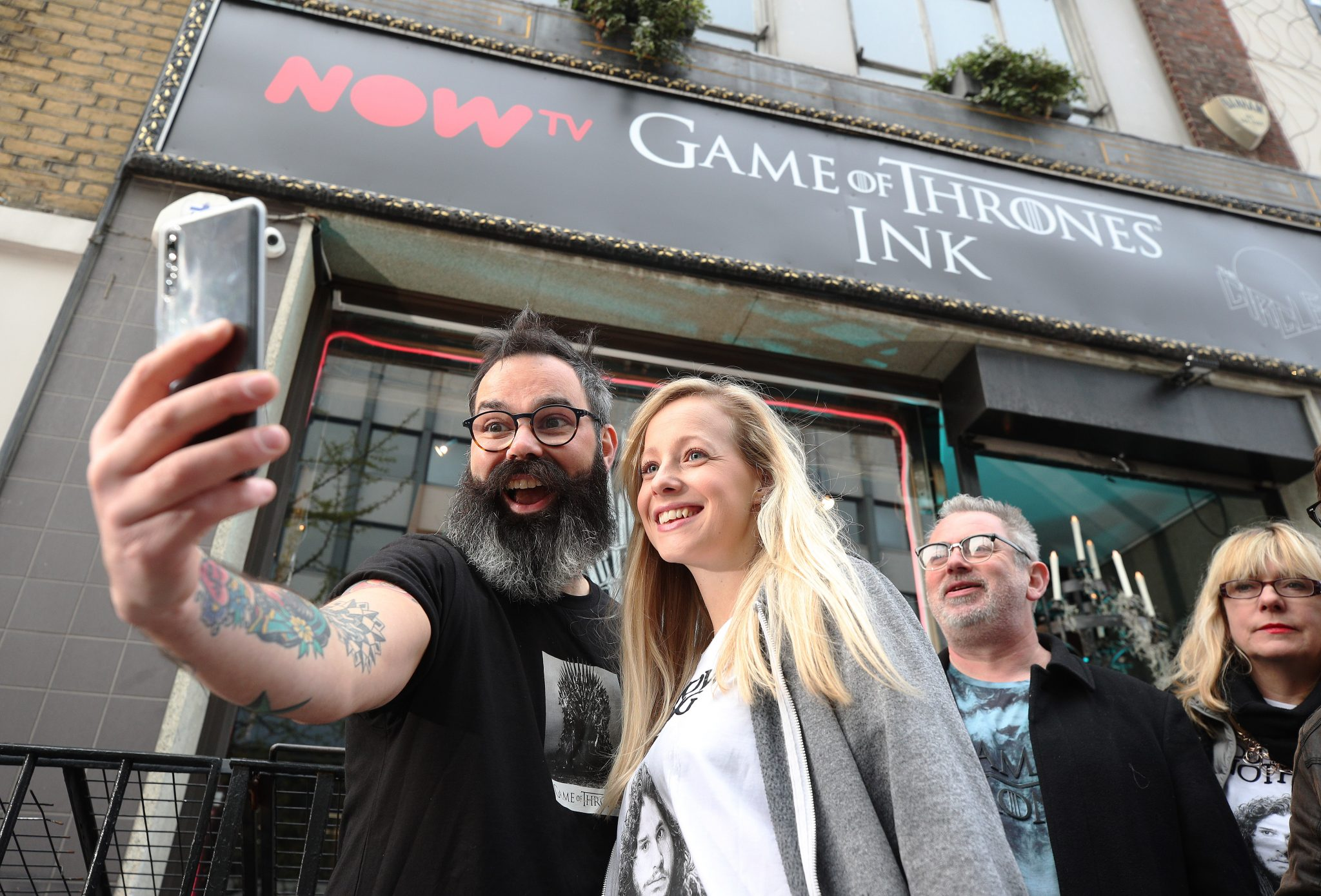 Superfans queue for FREE Game of Thrones tattoos at the NOW TV GoT INK studio. The studio is open on the 16th and 17th of April, to mark the start of Season 8