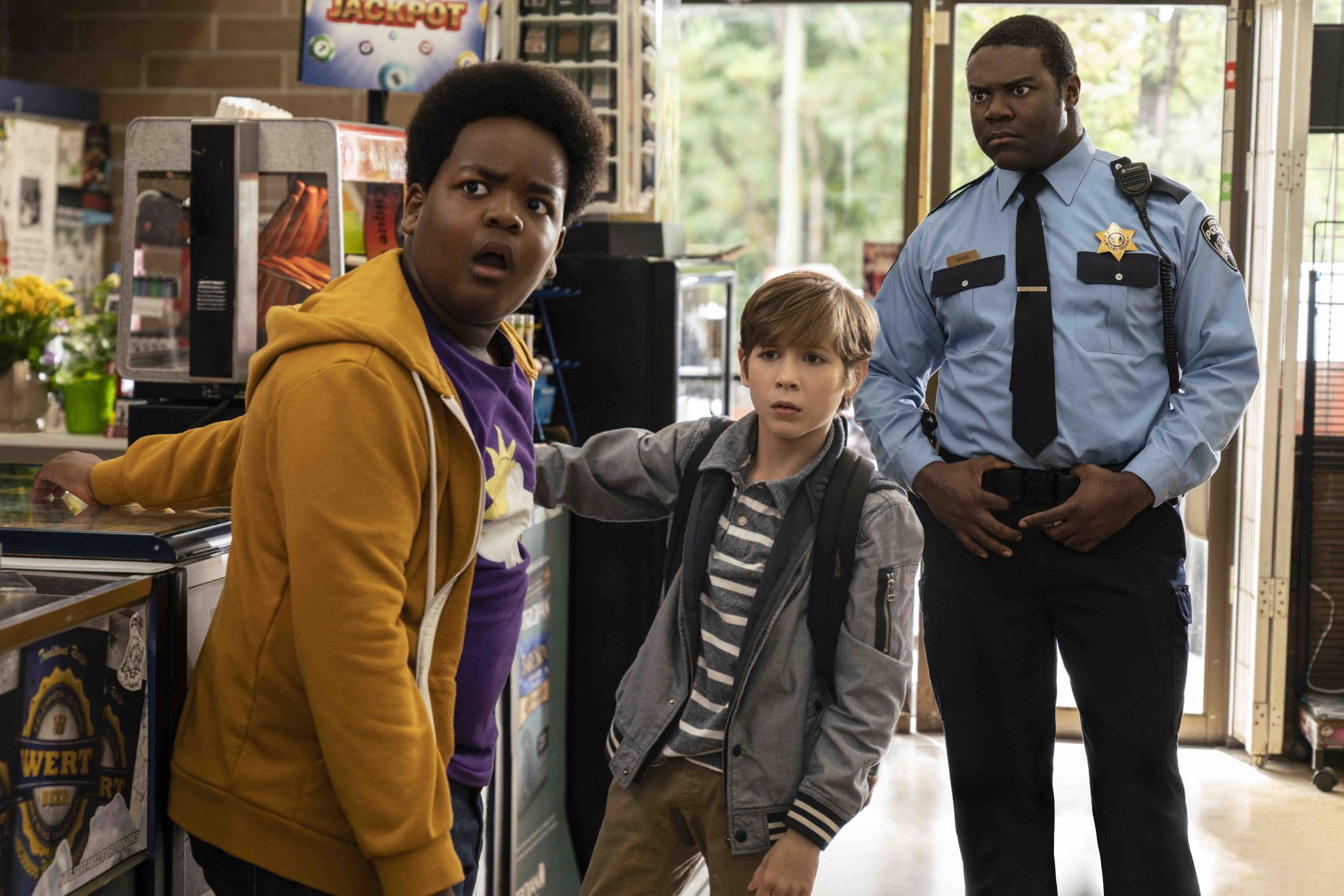 (from left) Lucas (Keith L. Williams), Max (Jacob Tremblay, and Sam Richardson (Officer Sacks) in Good Boys, co-written and directed by Gene Stupnitsky.