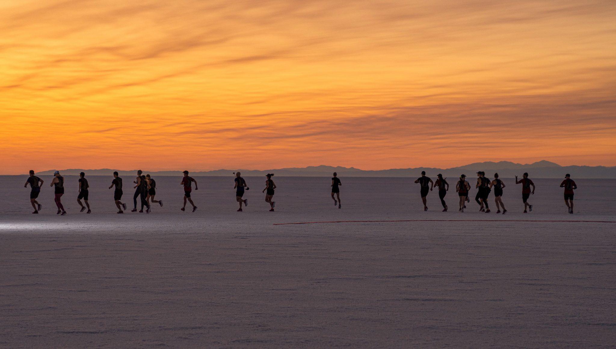 Runners start line sunrise