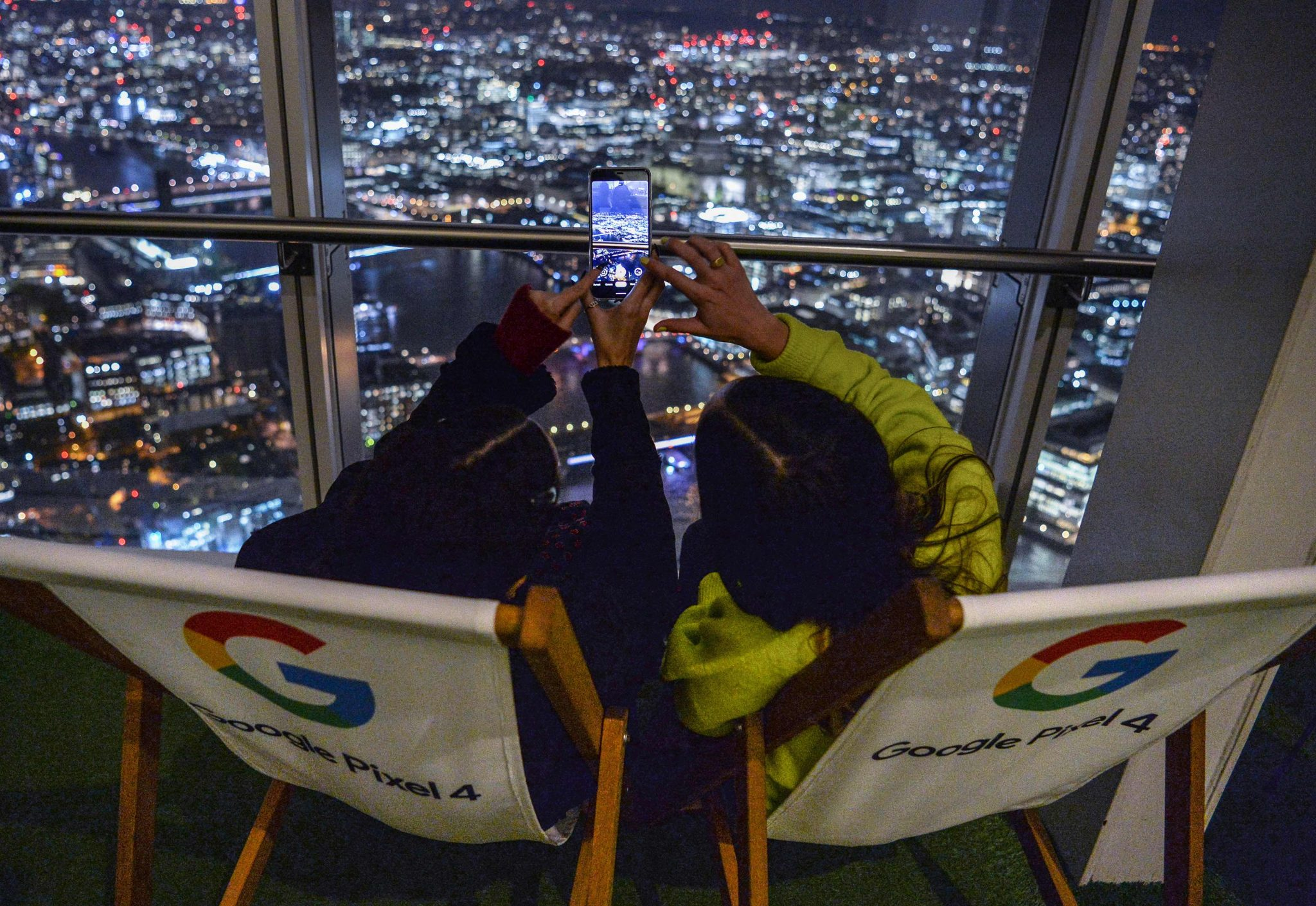 Guests test out the Google Pixel 4 Night Sight mode during an astrophotography evening hosted by Google Pixel 4 at the Shard, London. PA Photo. Picture date: Wednesday November 6, 2019. The Shard turned off its lights so guests at the event could get a clear view of the night sky to take pictures using the phone. The Google Pixel 4 launched last month with the new enhanced Night Sight mode, which can capture photos of the Milky Way in just one tap. Photo credit should read: Jeff Spicer/PA Wire