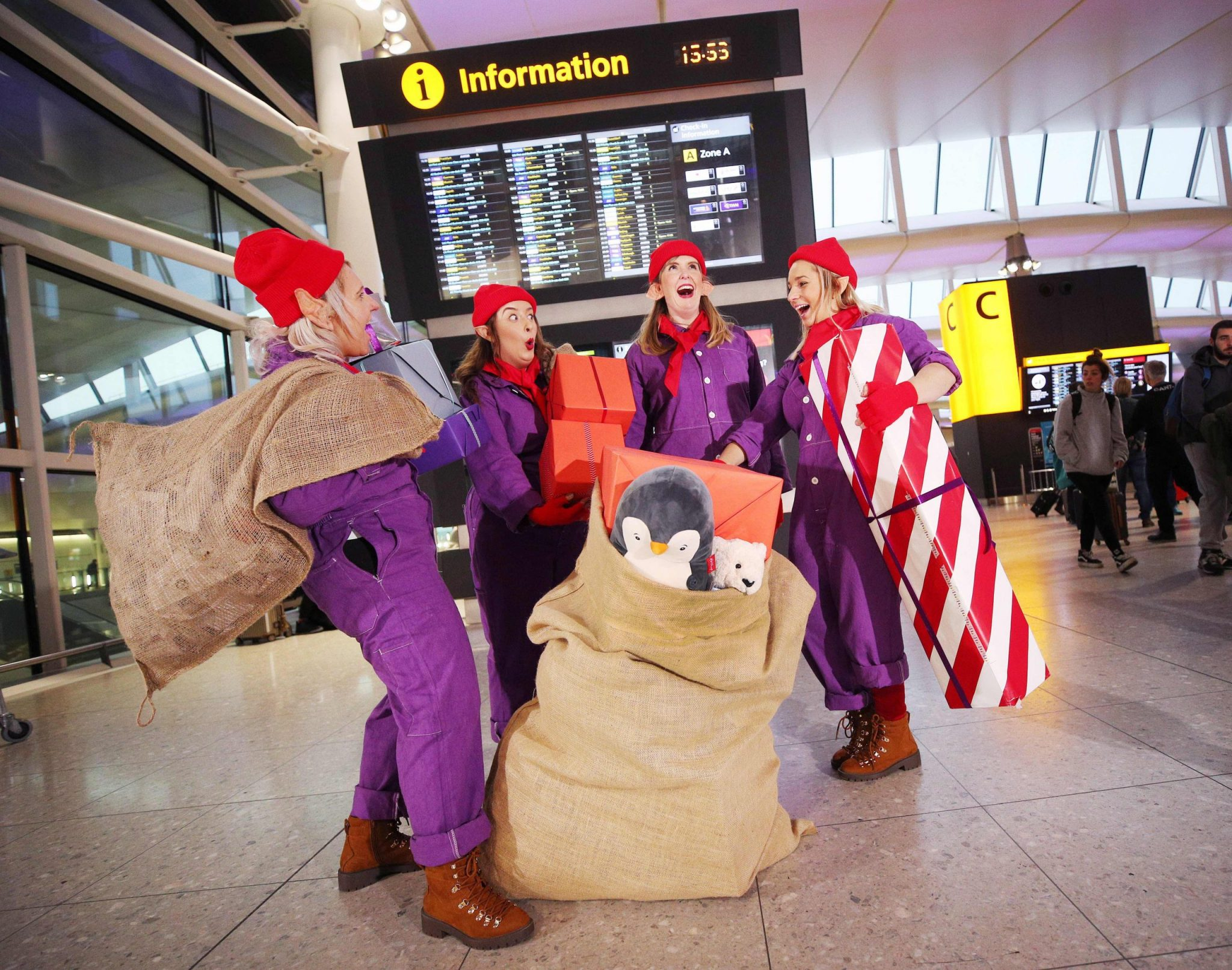 *** FREE FOR EDITORIAL USE *** Heathrow today unveils a long held secret: Santa's workshop is underneath Terminals 2 and 5.   Given the magical feat achieved by Santa and his team of elves each year – it's no wonder that, like many others around the world, he relies on the UK's hub airport to get to where he needs to be during the holidays. And what's more, Santa has built his entire workshop right underneath Heathrow's terminals.  Heathrow today unveils a magical installation of periscopes at Terminals 2 and 5 that will allow children (and adults) - throughout December - to immerse themselves, and witness the inner workings of Santa's incredible logistical feat for the very first time. Scenes from Santa's Toy Factory, Department of Wrapping and Mail Room all feature Heathrow's 'Elf Squad', acted out by the airport's very own colleagues, helping bring the magic alive for children and adults alike.