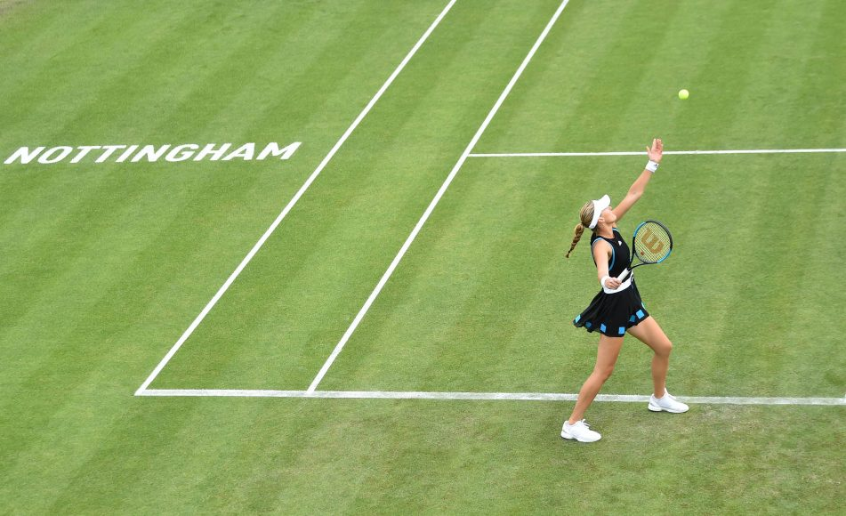 NOTTINGHAM, ENGLAND - JUNE 14: Kristina Mladenovic of France serves as she plays against Donna Vekic of Croatia during day five of the Nature Valley Open at Nottingham Tennis Centre on June 14, 2019 in Nottingham, United Kingdom. (Photo by Nathan Stirk/Getty Images for LTA)