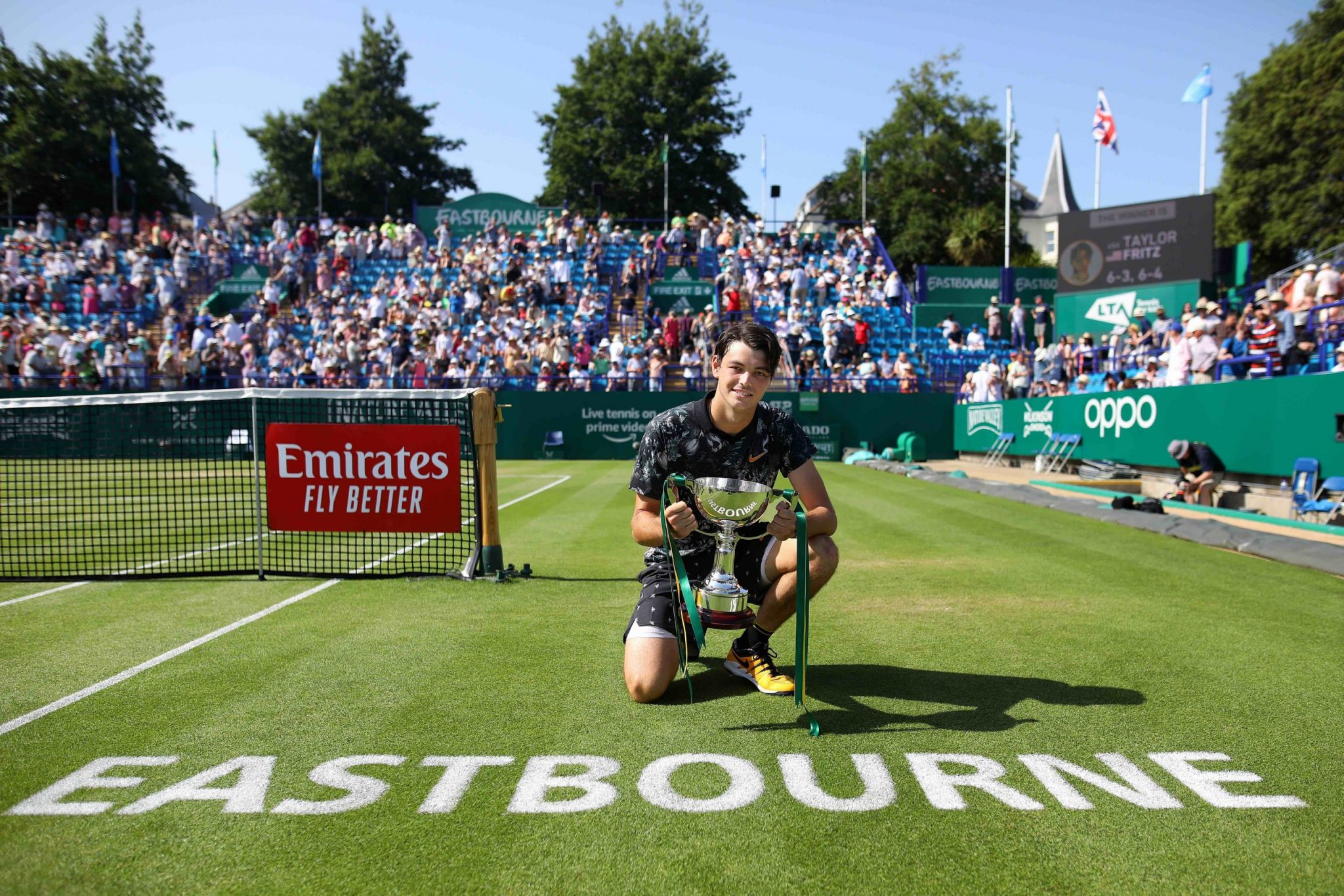 EASTBOURNE, ENGLAND - JUNE 29: Taylor Fritz of USA celebrates with the cup after winning the men's singles final against Sam Querrey of USA during day six of the Nature Valley International at Devonshire Park on June 29, 2019 in Eastbourne, United Kingdom. (Photo by Charlie Crowhurst/Getty Images for LTA) *** Local Caption *** Taylor Fritz