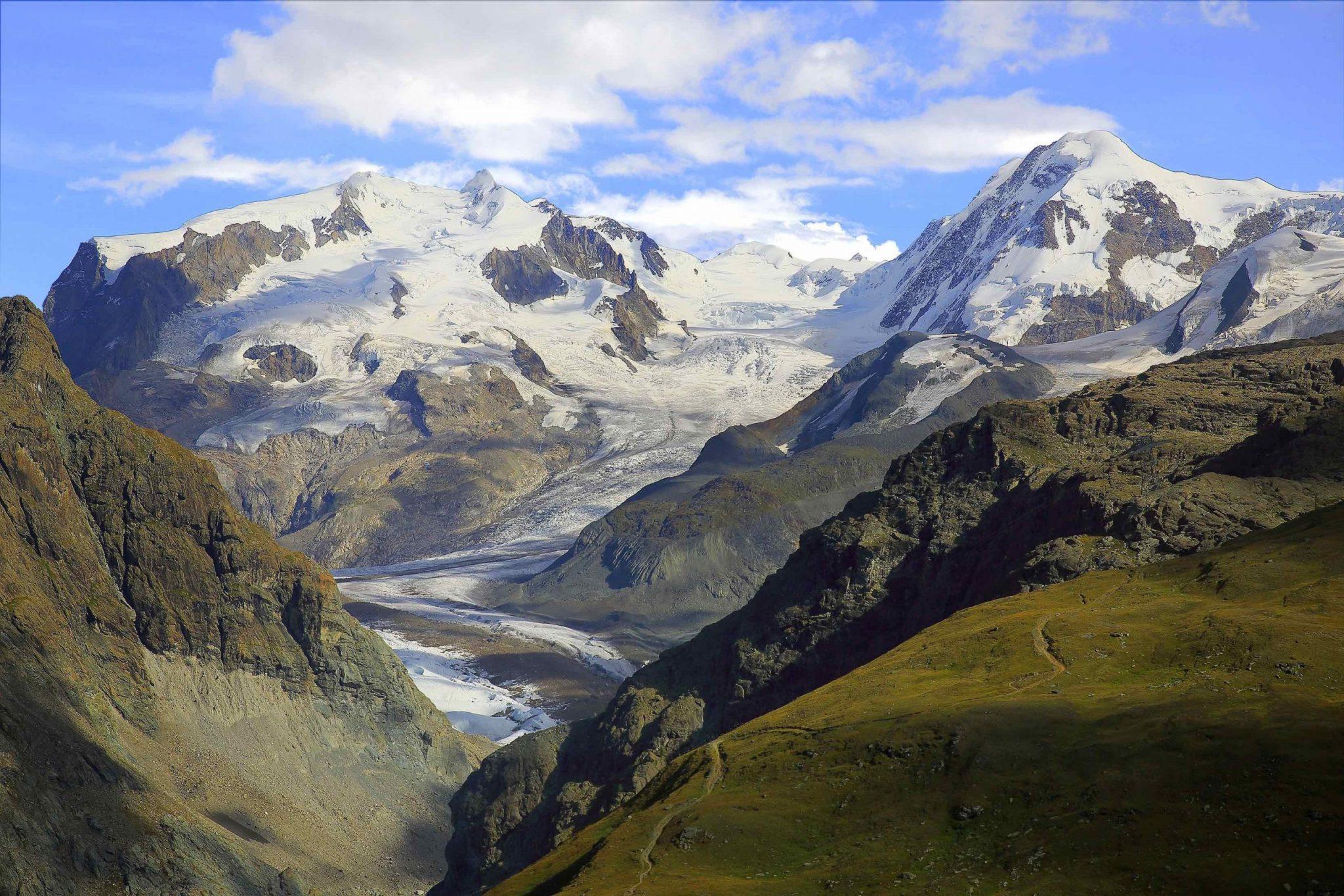 Idyllic Monte Rosa massif, Gorner glacier crevasses dramatic sunrise, Swiss Alps
