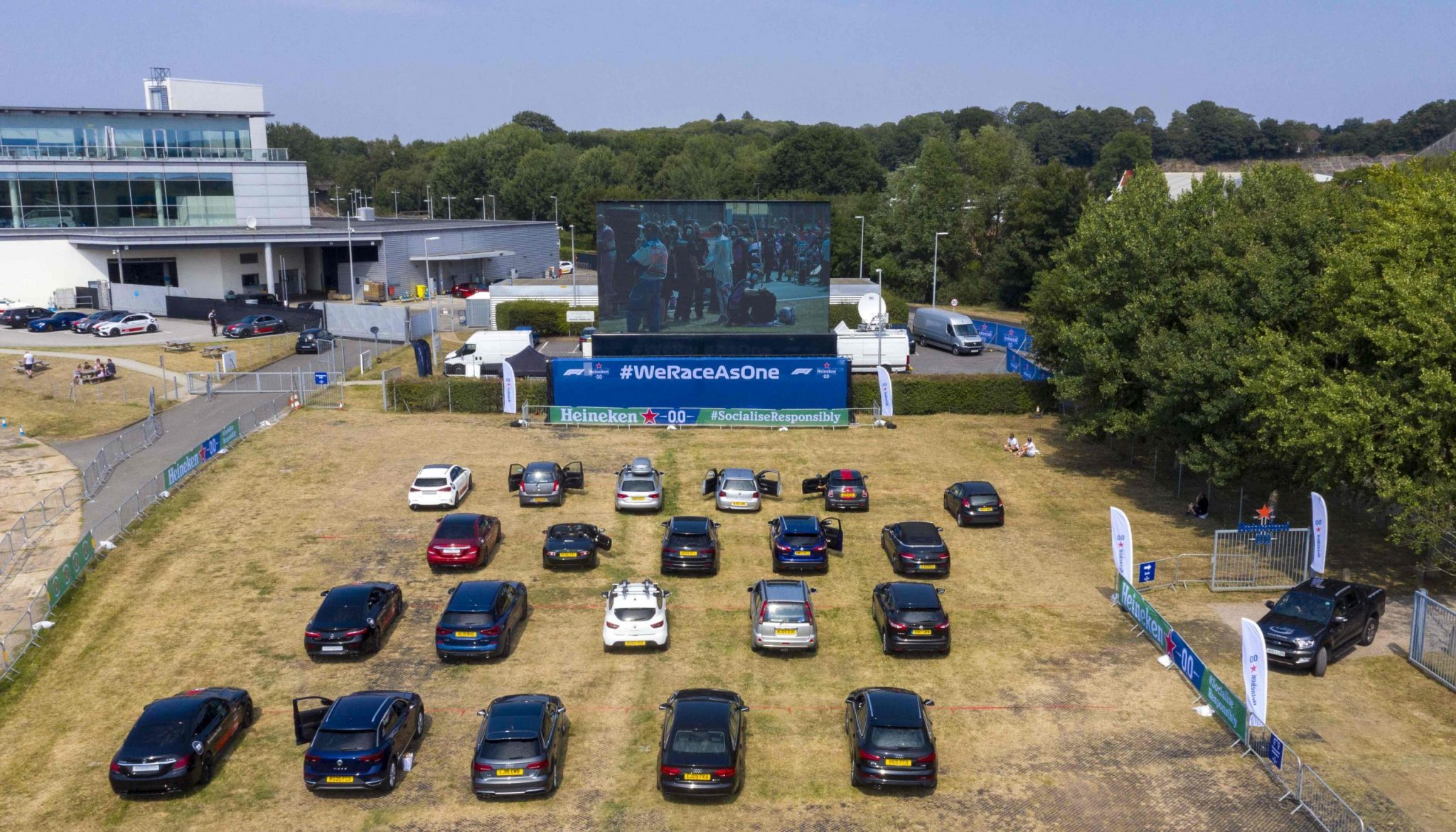 Aerial shots of guests enjoying a socially responsible drive-in screening experience, hosted by Heineken0.0, showing the Formula 1, 70th Anniversary Grand Prix Race, Weybridge. PA Photo. Picture date: Sunday August 9, 2020. As well as F1 fans, healthcare workers were amongst those invited by Heineken as a token of gratitude for all their support over the pandemic. They were given a passenger experience around the Mercedes-Benz World track with an expert racing driver and then watched the race in full. Photo credit should read: Steve Parsons/PA Wire