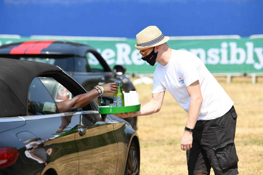 Guests enjoy a drive-in screening experience, hosted by Heineken 0.0%, showing the 70th Anniversary Grand Prix Race, Weybridge. PA Photo. Picture date: Sunday August 9, 2020. The guests are primarily healthcare workers, which Heineken selected to say thank you for their hard work over a difficult few months due to the COVID-19 pandemic. They were given a passenger experience around the Mercedes-Benz World track with an expert racing driver and then watch the race in full. Photo credit should read: Doug Peters/PA Wire