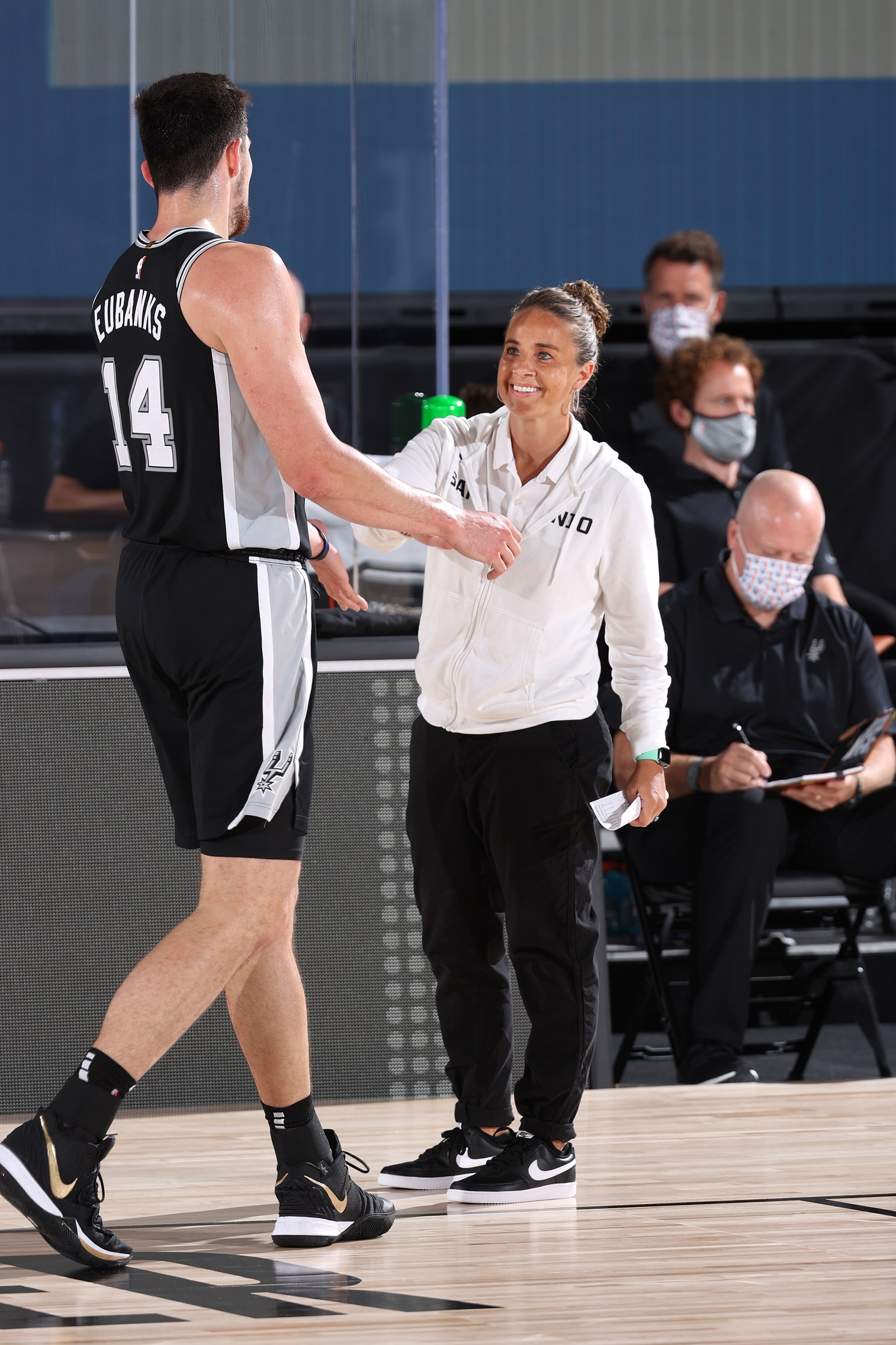ORLANDO, FL - JULY 23: Drew Eubanks #14 of the San Antonio Spurs high-fives assistant coach Becky Hammon of the San Antonio Spurs during the game on July 23, 2020 at the Visa Athletic Center at ESPN Wide World of Sports Complex in Orlando, Florida. Copyright Notice: Copyright 2020 NBAE (Photo by David Sherman/NBAE via Getty Images)
