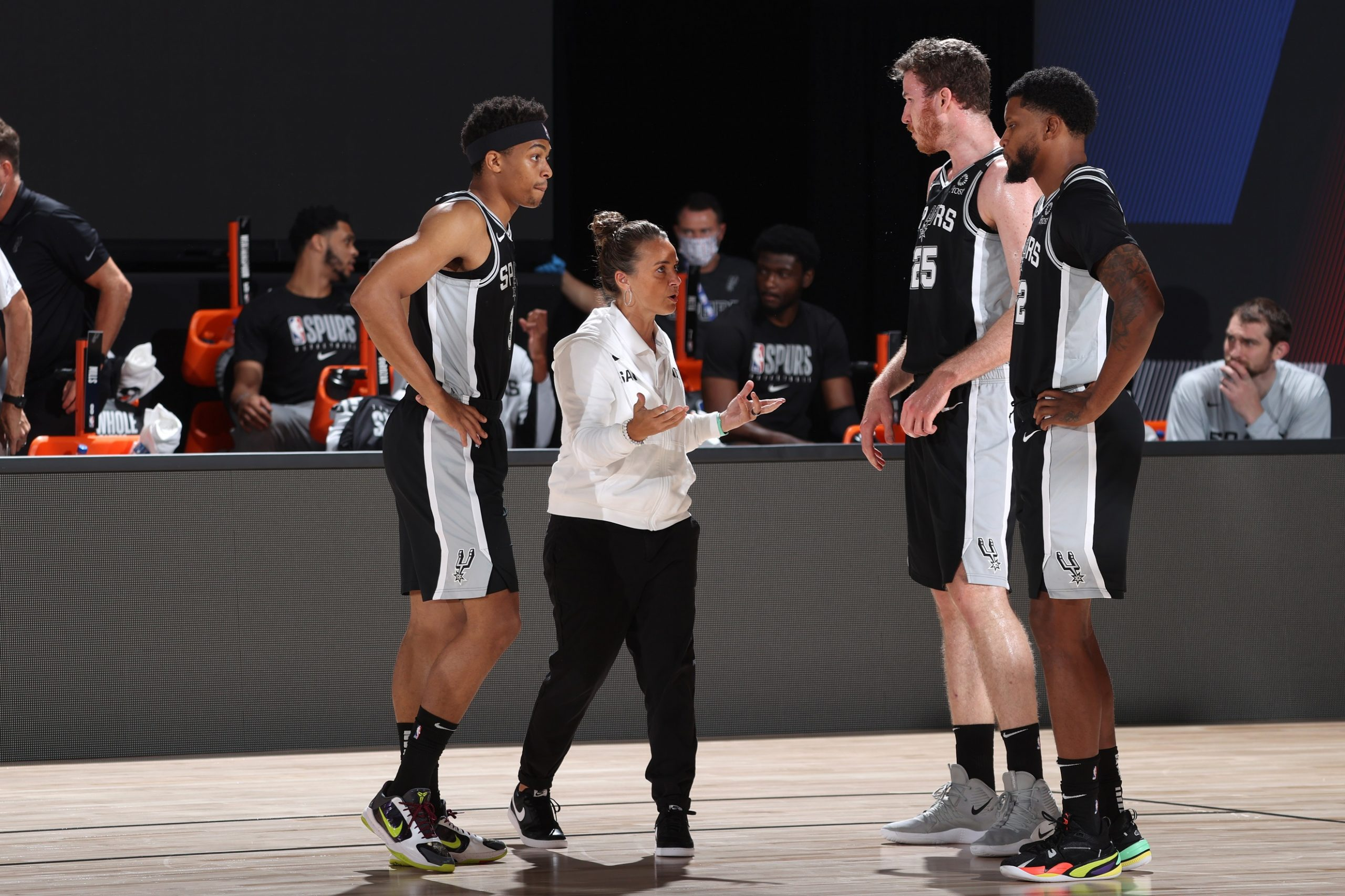 ORLANDO, FL - JULY 23: Assistant coach Becky Hammon of the San Antonio Spurs talks with her team in the huddle during the game on July 23, 2020 at the Visa Athletic Center at ESPN Wide World of Sports Complex in Orlando, Florida. Copyright 2020 NBAE (Photo by David Sherman/NBAE via Getty Images)