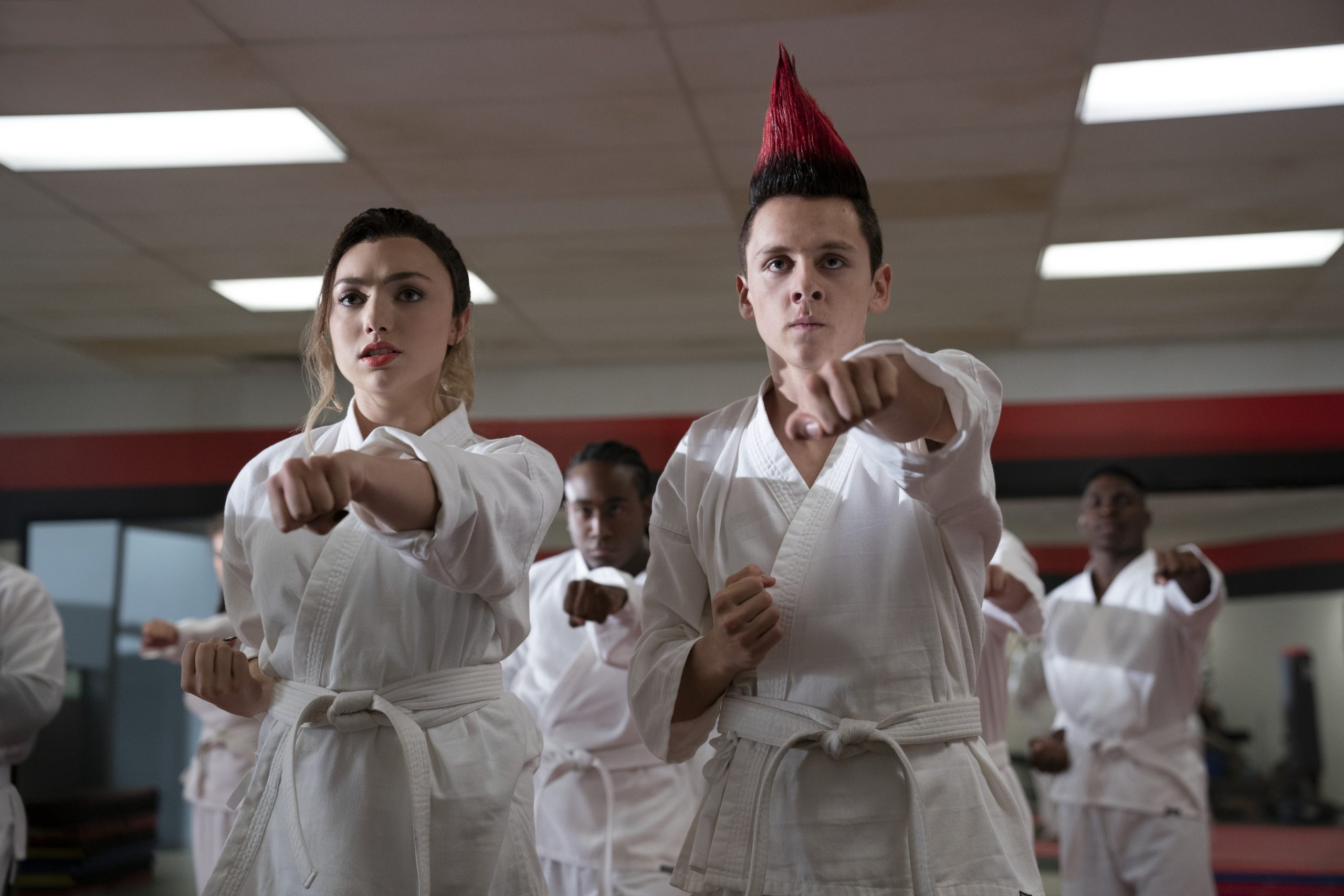 COBRA KAI (L to R) PEYTON LIST as TORY and JACOB BERTRAND as ELI in episode 308 of COBRA KAI Cr. BOB MAHONEY/NETFLIX © 2020
