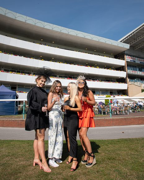 Race-goers raised stakes at Doncaster Racecourse today, despite the soaring temperatures